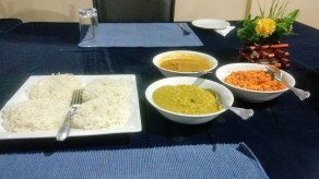 A wholesome breakfast of string hoppers, dal, chicken curry, and coconut sambol at Asnara Village, Habarana