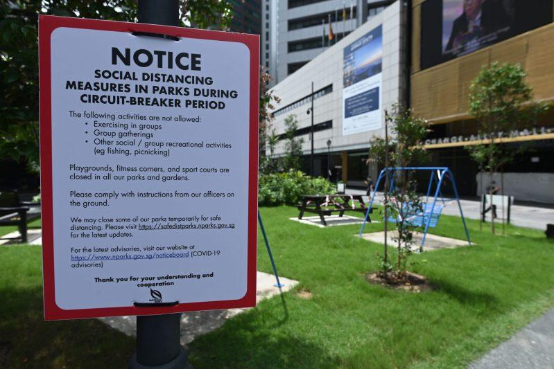 circuit breaker singapore surveillance Raffles Place social distancing