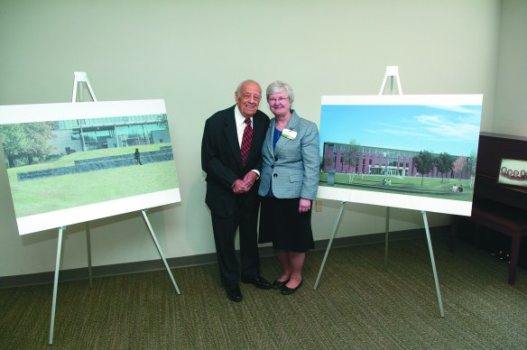 Michael J. Delfino and Sr. Anne Munley, IHM, president of Marywood University, stand in front of plans for Marywood's Amphitheatre at the new Learning Commons. Photo Credit: Marywood University