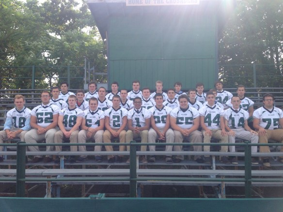 Members of the Holy Cross football team include, front row, from left: Casey Connolly, Dylan Michalek, Robert Murphy, Aaron Bogdanski, Josh Mies, Deion Lewis, Austin Shattin, Noah Sirianni, Matt Herne, Kevin Kizis, and Matt Nealon. Second Row: Connor Nealon, Nik Boniello, Mike Roberts, Jason Kopf, RJ Hernandez, Nick Klein, Tom Malone, Frank Scavo, Zach Zaluski. Third Row: Pat Pastore, JJ Backus, Sean Collins, Matt Warden, Bailey Simrell, Paul Marmo, Cory Miller, and Pat Kane. Josh Watters serves as head football coach.