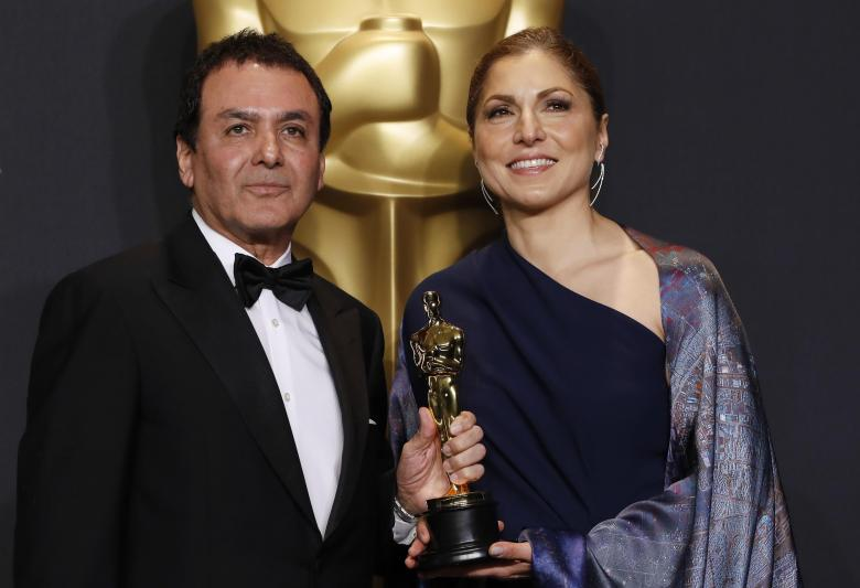 "89th Academy Awards - Oscars Backstage - Hollywood, California, U.S. - 26/02/17 - Anousheh Ansari and Firouz Naderi pose with the Oscar they accepted on behalf of Asghar Farhadi, who won the Best Foreign Language Film for ""The Salesman"". REUTERS/Lucas Jackson"