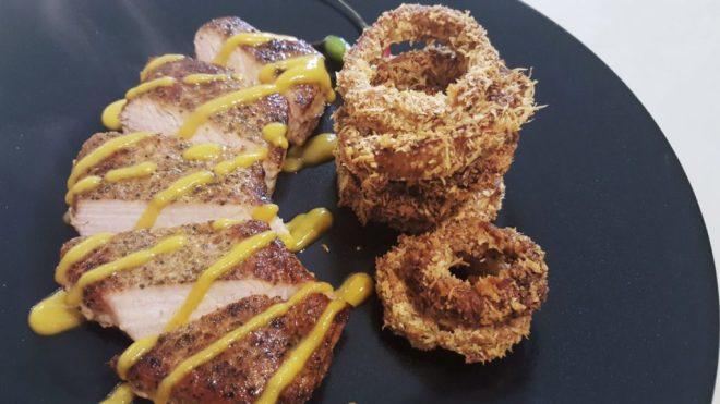 Cajun chops with papaya hot sauce and baked onion rings