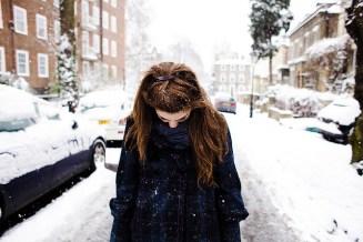 girl-in-snow-on-street