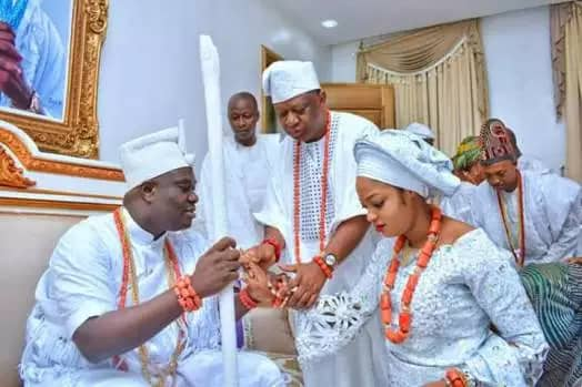 Image result for Ooni of Ife gets new queen walks on blood