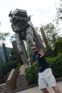 Jedi with lightsaber in front of AT-AT