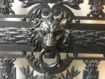 Ornate and thoughtful lion