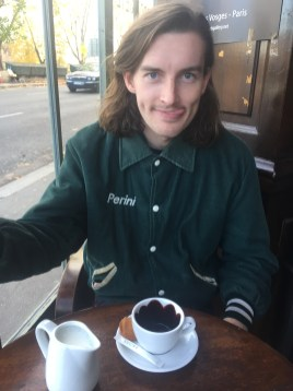 Eddie at the same cafe, this time waiting for Fraulein Mysterium