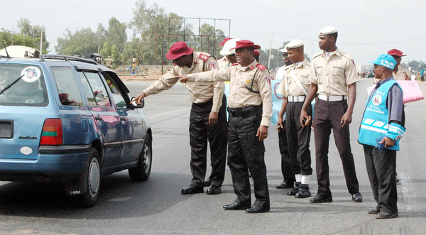 "PIC. 12.  FRSC ZONAL COMMANDER,  ASSISTANT CORPS MARSHAL, CHARLES THEOPHILUS (L), WITH SECTOR  COMMANDER, CORPS COMMANDER OLUMIDE OLAGUNJU, AT THE COMMENCEMENT FRSC ""OPERATION SHIELD"" ON   KADUNA - ABUJA HIGH WAY IN KADUNA ON MONDAY (6/5/13) ."