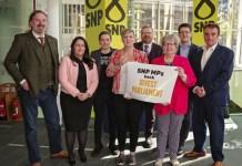 SNP MPs LtoR Chris Law, Angela Crawley, Mhairi Black, Hannah Bardell, Martyn Day, Marion Fellows, David Linden and TommySheppard