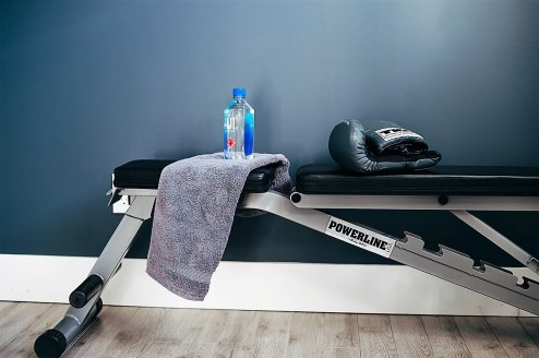 Adjustable weight bench is a must, this one was $200 from Rocky Mountain Fitness. Towels and Gloves also a must!