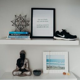 Simple Floating Shelves- $40 each from Home Depot. I keep my indoor only shoes up top, Beautiful digital photo reminding me I will be on a beach so push myself to get that sweat on! My mala beads & crystals for meditation, books and a Quote that keeps it all in perspective.