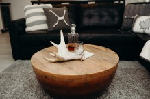 Decanter with Crown is a must in this house. Antler was sourced from our garage! Pillows from Portfolio Interiors here in Kamloops at about $40 a piece and the decanter & marble server we both less than $15 again at Home Sense