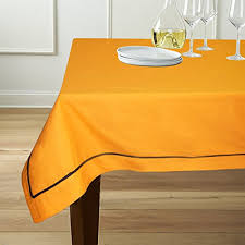 Simple piping on this table cloth elevates what could be a simple tablecloth to an elegant textile.