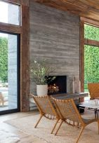 What better to lead to an outdoor area than this rustic inspired fireplace. The barnwood boards framed with the rustic beams screams Italian Villla! You can add rustic details to your home withOUT going farmhouse. Pair with modern furniture, glass accents, grennery and modern textured rugs to make it happen
