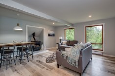 A sofa and love seat were selected to show that there is a TON of space for seating and this placement does not detract from the VIEW! So gorgeous.