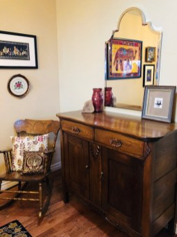 Stunning wood antiques are paired with a new mirror from Urban Barn