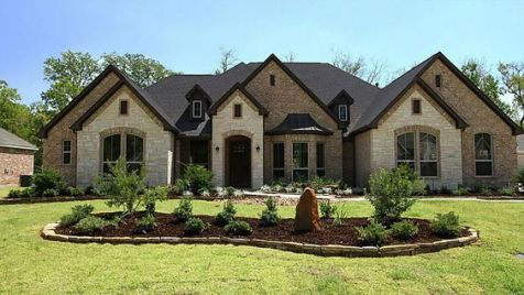 Stunning stone exterior creates a classic high end look.