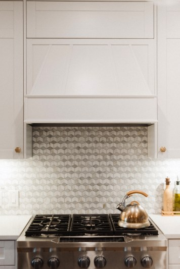 Custom millwork meets marble geo backsplash