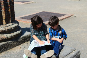 children reading map in Pompeii, Italy, Plan the Perfect Trip, www.theeducationaltourist.com