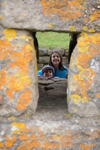 Boy and girl peering through stone wall, Canada Travel Itinerary, www.theeducationaltourist.com