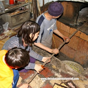 children cooking bread in morocco, vacation photo tips, www.theeducationaltourist.com