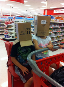 kids in grocery cart wearing boxes on heads, Traveling with Teens, www.theeducationaltourist.com