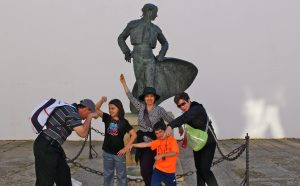 family acting silly in front of statue, Traveling with Teens, www.theeducationaltourist.com