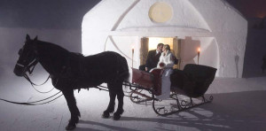 photo from Quebec's Glace Ice Hotel, unusual hotels with kids, horse drawn carriage