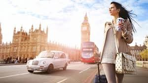 woman walking in london with big ben in the background
