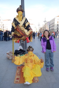 girl in Madrid with street performers, travel myths