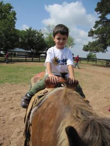 boy riding a horse, travel myths
