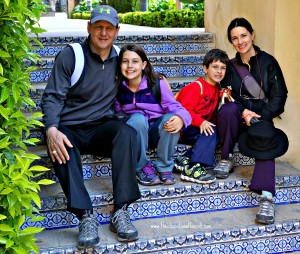 The Educational Tourist and family on tiled steps in Spain, Traveling with Kids: Top Tips, www.theeducationaltourist.com