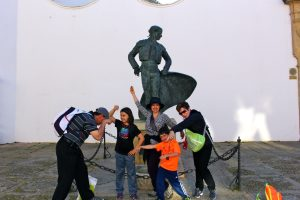 The Educational Tourist and family in front of statue,  Planning a Family Adventure, www.theeducationaltourist.com