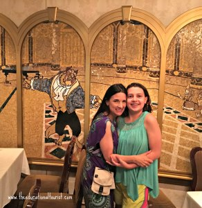 The Educational Tourist and girl on Disney cruise in dining room with mosaic art