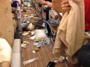 trash on plane floor from turbulence - photo from Alan Cross, Safe Flying for Families, www.theeducationaltourist.com