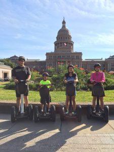 family on segway Austin texas state capital