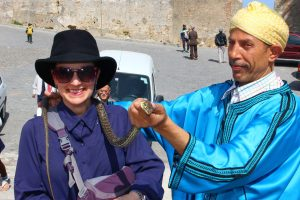 The Educational Tourist with a snake charmer in Morocco, Travel outside your comfort zone, www.theeducationaltourist.com