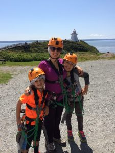The Educational Tourist ready to zip line at Cape Enrage in Canada, Travel outside your comfort zone, www.theeducationaltourist.com