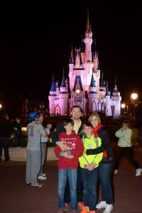 family in front of Cinderella's castle at Disney World, Disney Made Easy, www.theeducationaltourist.com