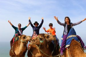 Camel riding with kids in Morocco
