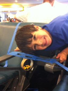 boy using imagination to play in airport