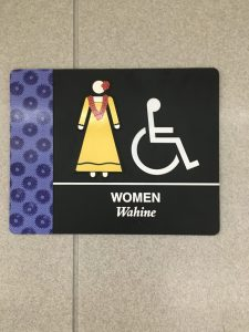 Restroom sign with woman wearing lei, Flowers of Hawaii, www.theeducationaltourist.com