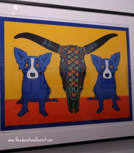 2 blue dogs flanking a steer skull, Blue Dog, www.theeducationaltourist.com
