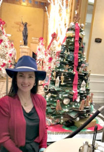 The Educational Tourist with large gingerbread house in New Orleans