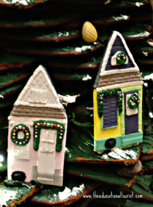 gingerbread ornaments of shotgun house doors in cafe at New Orlean's Roosevelt hotel, New Orleans Christmas Decorations, www.theeducationaltourist.com