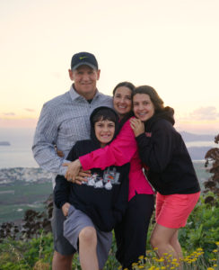 Family of four in Santorini at sunset