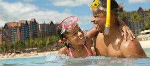 father daughter snorkeling at Aulani Disney resort in Hawaii