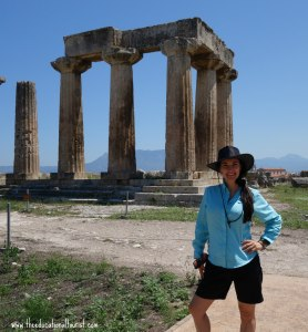 The Educational Tourist with temple ruins in Ancient Corinth, Greece