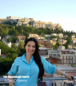 The Educational Tourist in Athens with acropolis in background, www.theeducaitonaltourist.com