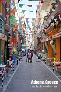 Colorful street in Athens, Greece, mom and kids